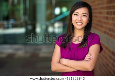 Genuine natural headshot portrait of mixed ethnicity feminist woman standing strong powerful confident
