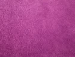 Genuine purple cattle leather texture background. Macro photo