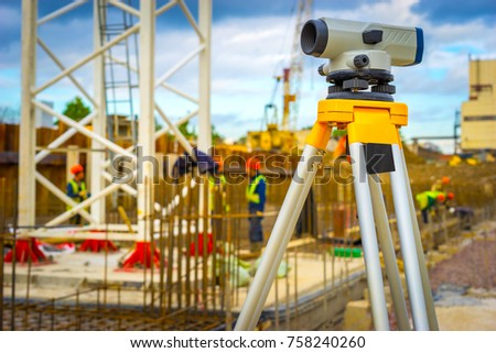 Geodetic measurements on the construction site. Theodolite at the construction site.