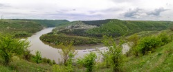 Geological landscape. The most complete section of Silurian and Devonian sediments Paleozoic age. The village of Kitaygorod and the Ternava River. Kitaygorod outcrop. Podilski Tovtry panorama
