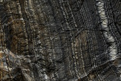 Geological layers on a stone wall. Abstract close up of rock strata taken at Barents sea coast.
