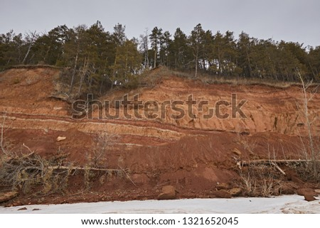 Geological outcrop with layers of earth rock. The texture of the word of soil and clay, which has developed over thousands of years. Archaeological excavations #1321652045