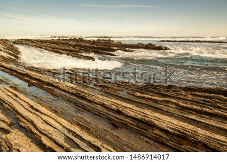 Geological rock formations and cliffs on the Flysch route. Cantabrian Sea. In Vizcaya, Basque Country. Spain #1486914017