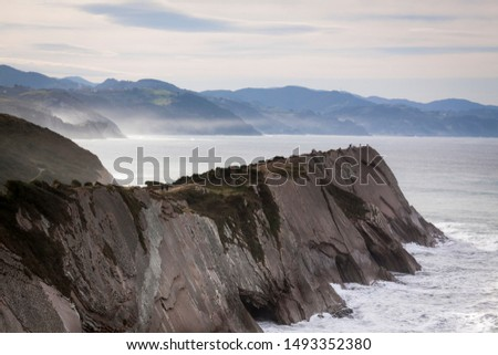 Geological rock formations and cliffs on the Flysch route. Cantabrian Sea. In Vizcaya, Basque Country. Spain #1493352380