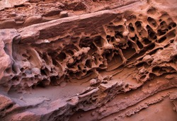 Geology and tectonic plates. Sedimentary rocks natural texture and pattern. Closeup view of red canyon rock balls and prehistoric fossils in a jurassic cave in La Rioja, Argentina.