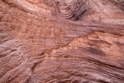 Geology. Natural texture and pattern. Closeup view of the red sandstone and rocky formation in the desert.