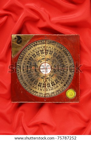 Geomancy compass on red background
