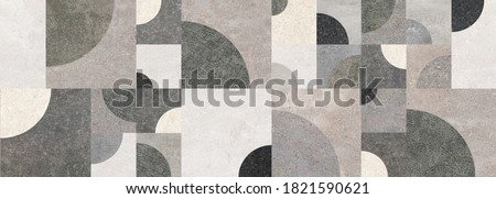 Photo of  Geometric decoration formed by different cement textures. Geometric wall.