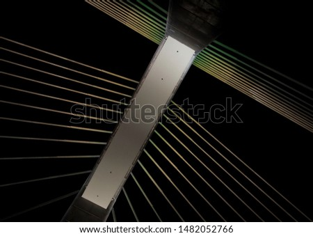Geometric game in a cityscape. Night cityscape from a bridge.