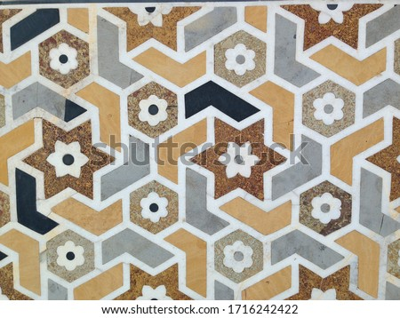Photo of  Geometric hexagon and star floral wall tile pattern close up on masjid mosque in Morocco
