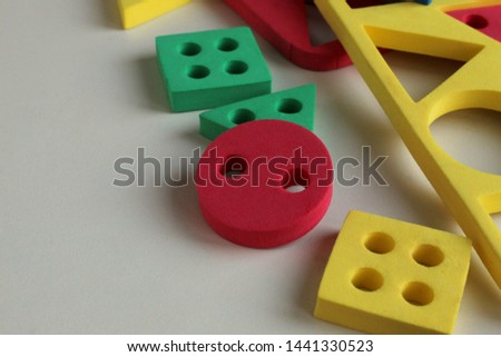 Geometric shapes children's puzzles on a white background, logical games, selective focus. #1441330523
