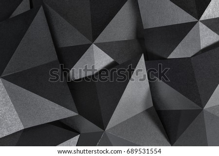 Geometric shapes of paper in black and white, grainy paper texture #689531554