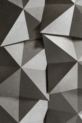 Geometric shapes of silvery paper, grainy texture