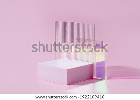 Geometric shapes podium for product display. Monochrome platform  with gloss acrylic sheets on pink background. Stylish background for presentation. Minimal style. Stockfoto ©