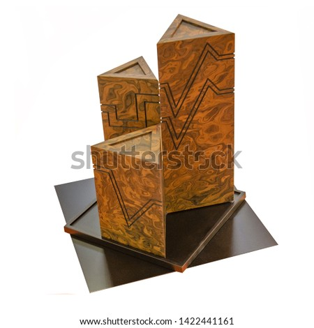 Geometric shapes still life composition. Three-dimensional prism a pyramid of three high triangles made of granite on an isolated background. The simplicity of the concept pictures