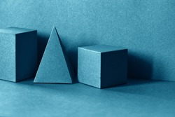 Geometrical figures still life composition. Three-dimensional pyramid rectangular cube objects. Platonic solids figures, simplicity concept photography
