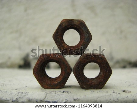 geometrical shape of rusted nuts. #1164093814