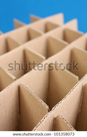 Geometry abstract shape of cardboard paper. isolated on blue background