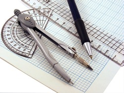 Geometry set with compass,pen,ruler & protractor on graph paper
