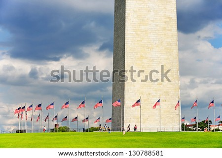 George Washington Monument. People and flag poles, by comparison, give a good idea of the massive size of the obelisk. The world's tallest stone structure and the highest structure in Washington D.C.