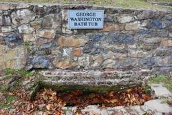 George Washington natural spring water bathtub at a park in Berkeley Springs, WV, USA.