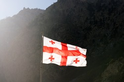 Georgia flag on a background of mountains