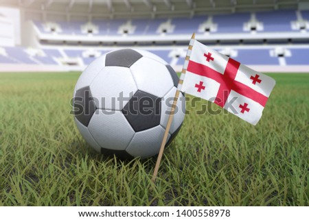 Georgian flag in stadium field with soccer football #1400558978