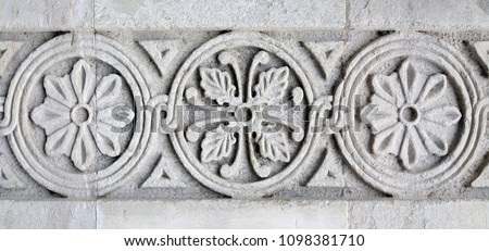 Georgian Traditional ornaments are inscribed on the stone #1098381710