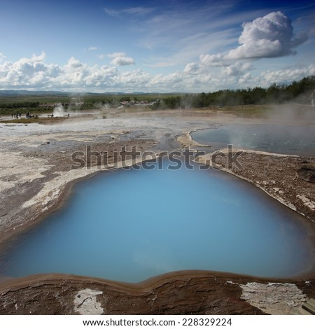 Geothermal activity near Geysir in Iceland. Colorful soil and steaming hot springs. Travel destination. Square composition.