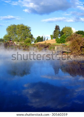 Geothermal Activity of Kuirau Park, with wooden lookout and cloud reflections through the steam. Rotorua, New Zealand