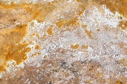Geothermal alternative energy concept. Texture of earth at Hverir geothermal area, north of Iceland. Rusty ground texture.  Multi colored sulfur background.