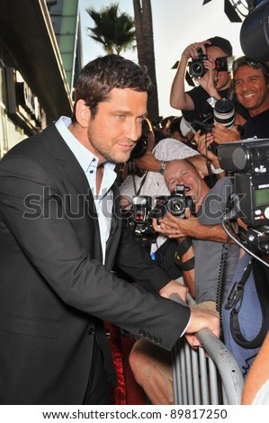 """Gerard Butler at the premiere of his new movie """"The Ugly Truth"""" at the Cinerama Dome, Hollywood. July 16, 2009  Los Angeles, CA Picture: Paul Smith / Featureflash"""