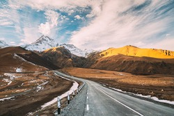 Gergeti, Georgia. Open Road To Peak Of Mount Kazbek In Autumn Season. Kazbek Is A Stratovolcano And One Of Major Mountains Of Caucasus. Beautiful Georgian Nature Landscape In Early Winter.