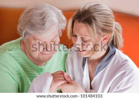 Geriatric nurse at  house visiting of an senior woman