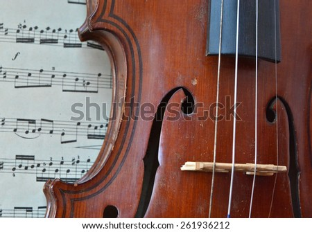 German ancient violin and notes. Old violin, copy of Majini made Saxony, in the 19th century.