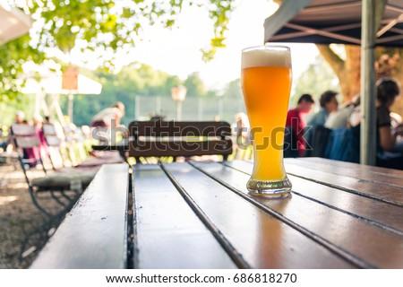 German Beer 0,5 Liter on Wooden Table Biergarten Traditional Culture Beautiful Day