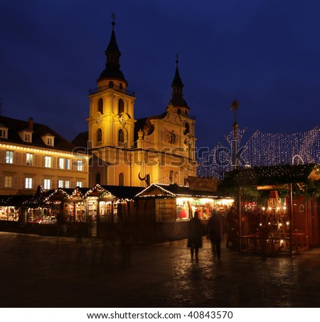 German christmas market at night with people in motion