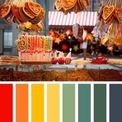 German Christmas street market in Berlin, with sweet festive treats containing seasonal greetings messages to family members, candies and nuts. In a colour palette with complimentary colour swatches.