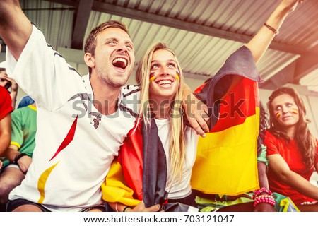 German Couple Supporting the Team, Soccer Championship ストックフォト ©