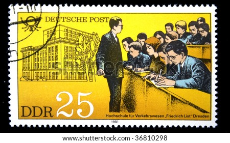 German Democratic Republic - CIRCA 1981: A stamp printed in GDR shows building of school, an audience with students and the teacher, one stamp from series devoted Training of personnel , circa 1981