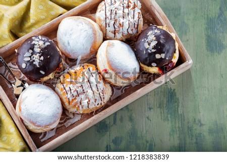 German donuts - krapfen or berliner - filled with jam