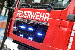 German fire engine in action with alarm light / Feuerwehr means Fire Department