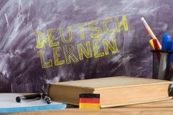 German flag, book and German translation for learning German
