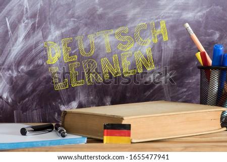 German flag, book and German translation for learning German ストックフォト ©