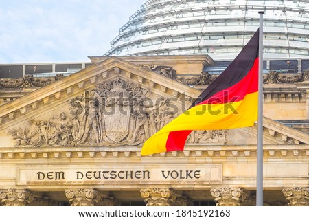 German flag on a background Reichstag building. The seat of the German Parliament or Bundestag, Berlin Mitte district. Inscription in German: To the German People Photo stock ©