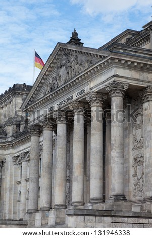 German flag streaming in front of the German parliament building, the Reichstag at Berlin, Germany.