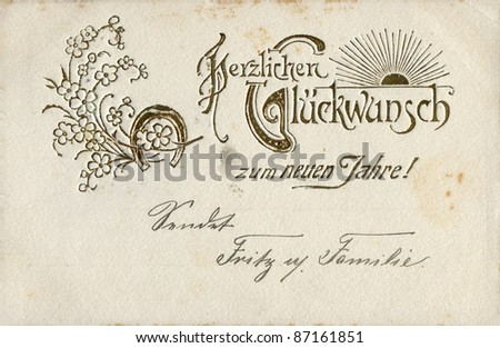 "German greeting postcard ""I heartily congratulate with New Year!"", depicts the sun, flowers and a horseshoe, circa 1905"