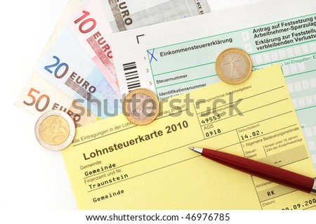 German Income tax card 2010 with ballpoint pen and Euro money