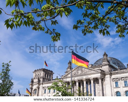 german parliament in spring with a tree and leaves