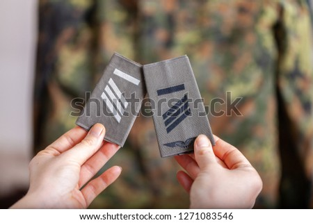 german shoulder ranks on a camouflage background #1271083546